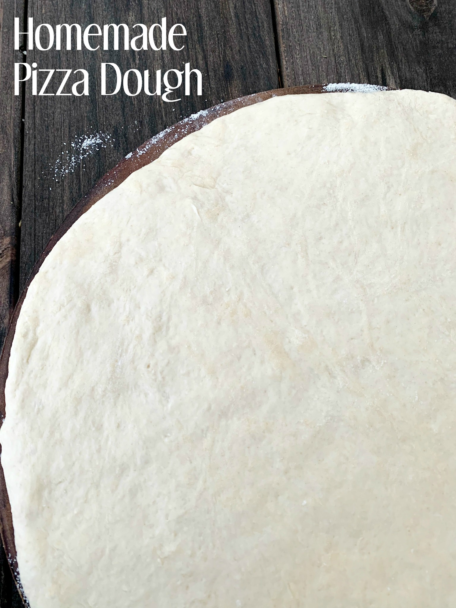 pizza dough rolled in a circle and showing only on corner of it