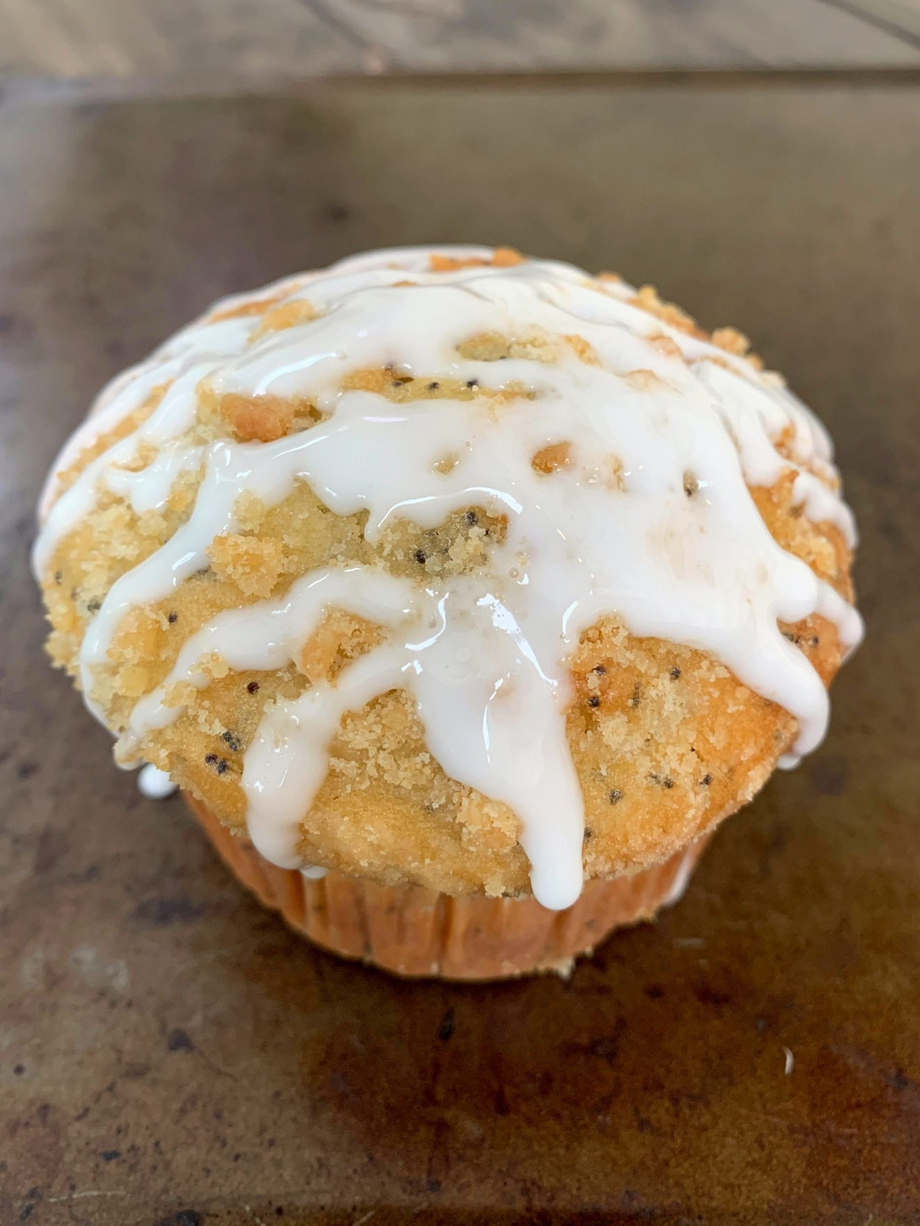 a lemon muffin drizzled with glaze