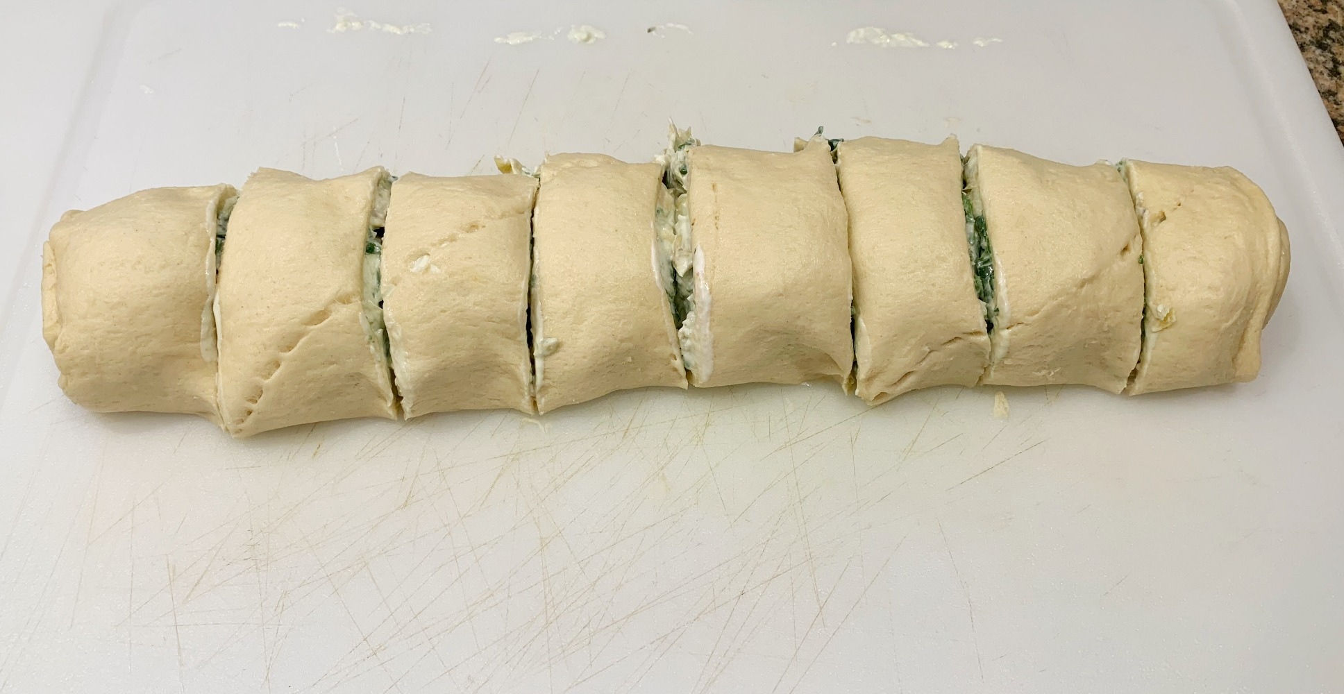 the crescent roll is rolled up with the dip inside it and cut into 8 pieces.
